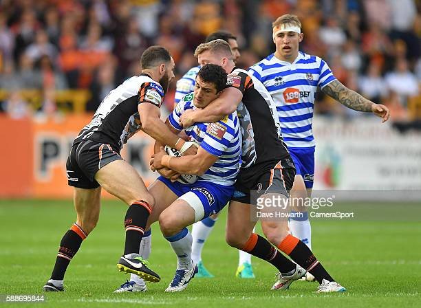 Wigan Warriors' Ben Flower is tackled by Adam Milner and Castleford Tigers' Luke Gale First Utility Super League Super 8s Round 2 between Castleford...
