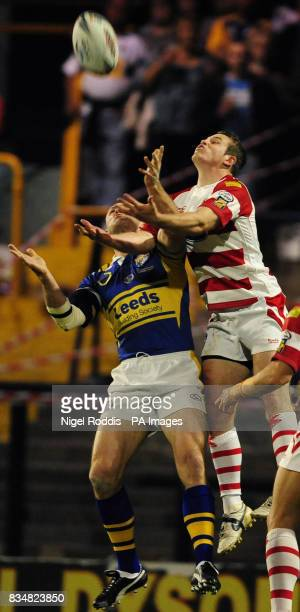 Wigan Warriors' Cameron Phelps challenges Leeds Rhinos' Keith Senior in the air during the Engage Super League Grand Final Eliminator at Headingley...