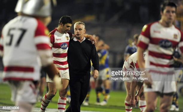 Wigan Warriors coach Brian Noble consoles Standoff Trent Barrett after losing the game to Leeds Rhinos following the Engage Super League Grand Final...