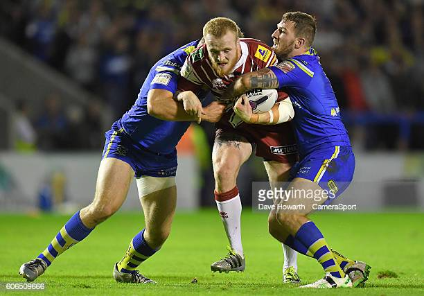 Wigan Warriors' Dom Crosby is tackled during the First Utility Super League Super 8s Round 6 match between Warrington Wolves and Wigan Warriors at...