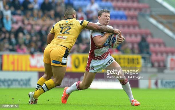 Wigan Warriors George Williams is tackled by Castleford Tigers Weller Hauraki during the Tetley's Challenge Cup Quarter Final match at the DW Stadium...