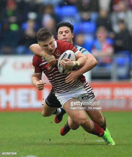 Wigan Warriors' George Williams is tackled by CronullaSutherland Sharks' Chad Townsend during the 2017 Dacia World Club Series match at the DW...