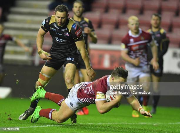 Wigan Warriors' George Williams scores his team's 2nd try during the Betfred Super League Round 3 match between Wigan Warriors and Leigh Centurions...