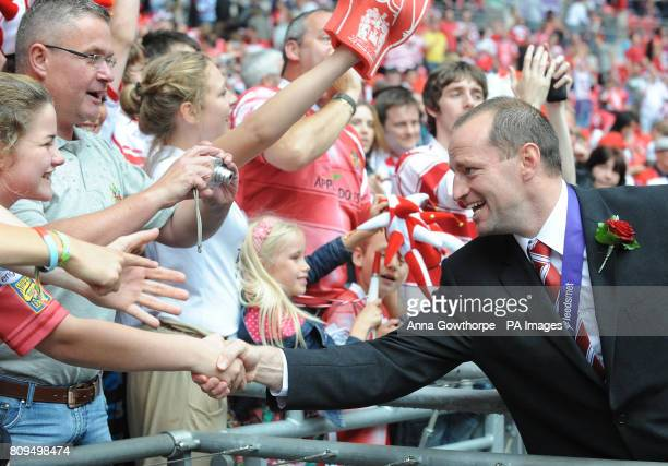 Wigan Warriors' Head Coach Michael Maguire celebrates with the fans after winning the Carnegie Challenge Cup Final at Wembley Stadium London