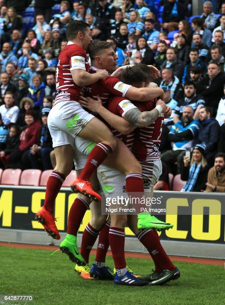 Wigan Warriors' Joe Burgess celebrates after scoring the opening try of the game against CronullaSutherland Sharks during the 2017 Dacia World Club...