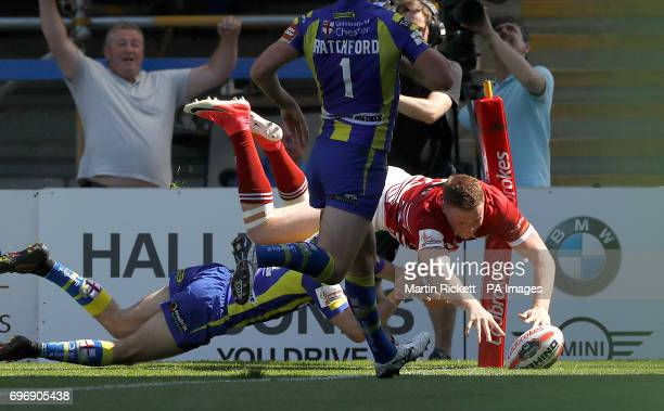 Wigan Warriors' Joe Burgess goes over for a try against Warrington Wolves during the Ladbrokes Challenge Cup quarterfinal match at Halliwell Jones...