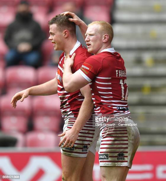 Wigan Warriors' Joe Burgess is congratulated on scoring his team's opening try during the Betfred Super League Round 9 match between Wigan Warriors...