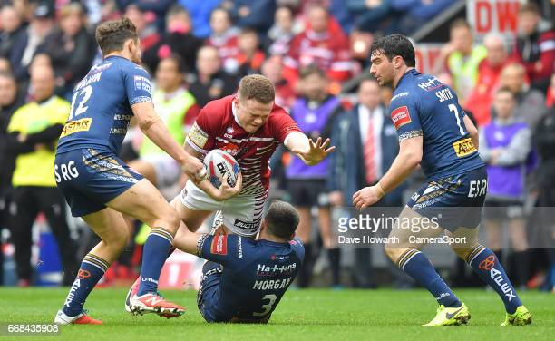 Wigan Warriors' Joe Burgess is tackled during the Betfred Super League Round 9 match between Wigan Warriors and St Helens at DW Stadium on April 14...