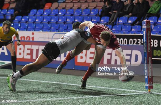 Wigan Warriors' Joe Burgess scores his sides 3rd try during the Betfred Super League Round 2 match between Widnes Vikings and Wigan Warriors at...