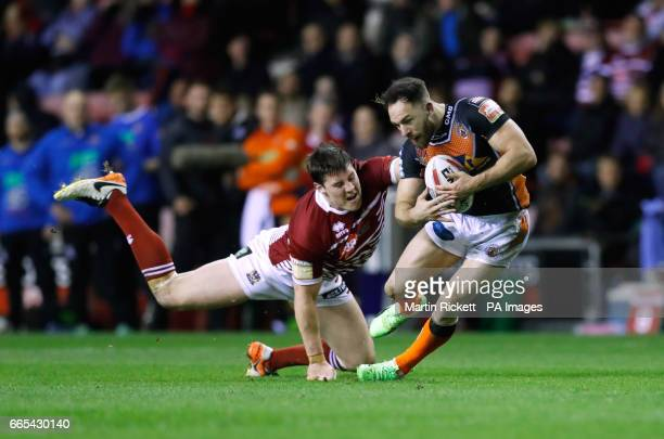 Wigan Warriors' Joel Tomkins tackles Castleford Tigers' Luke Gale during the Betfred Super League match at The DW Stadium Wigan