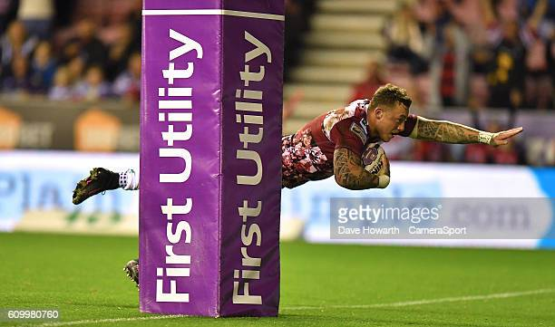 Wigan Warriors' Josh Charnley scores a try for his team during the First Utility Super League Super 8s Round 7 match between Wigan Warriors and...