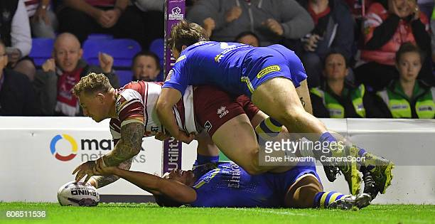 Wigan Warriors' Josh Charnley scores his sides 3rd try during the First Utility Super League Super 8s Round 6 match between Warrington Wolves and...
