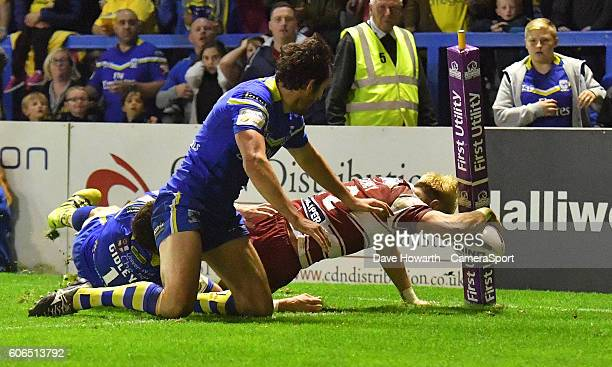 Wigan Warriors' Lewis Tierney scores his sides 5th try during the First Utility Super League Super 8s Round 6 match between Warrington Wolves and...