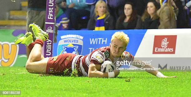 Wigan Warriors' Lewis Tierney scores the opening try of the game during the First Utility Super League Super 8s Round 6 match between Warrington...