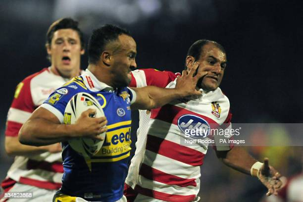 Wigan Warriors' Mark Calderwood is held off by Leeds Rhinos' Jamie JonesBuchanan during the Engage Super League Grand Final Eliminator at Headingley...