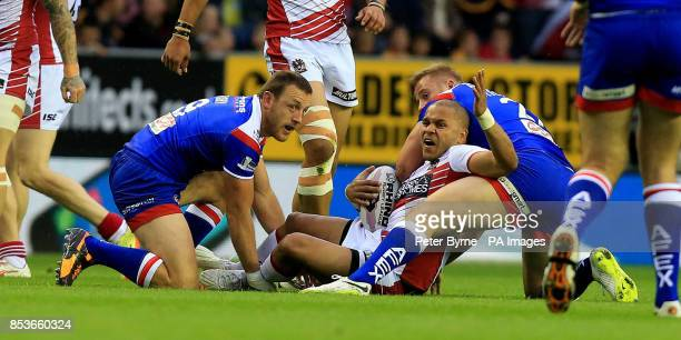 Wigan Warriors Matty Bowen is tackled by St Helens James Roby during the First Utility Super League at the DW Stadium Wigan