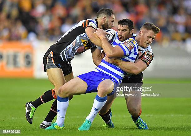 Wigan Warriors' Matty Smith is tackled by Castleford Tigers' Luke Gale and Larne Patrick during the First Utility Super League Super 8s Round 2...