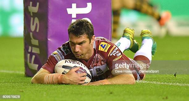 Wigan Warriors' Matty Smith scores his team's 7th try during the First Utility Super League Super 8s Round 7 match between Wigan Warriors and...