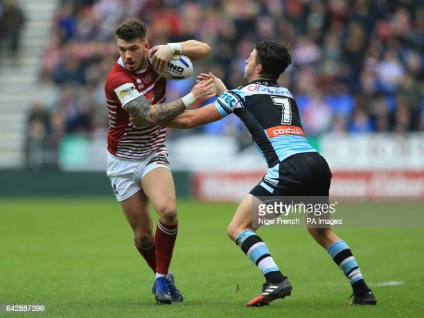 Wigan Warriors' Oliver Gildart is tackled by CronullaSutherland Sharks' Chad Townsend during the 2017 Dacia World Club Series match at the DW Stadium...