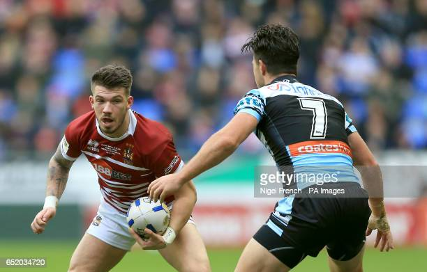 Wigan Warriors' Oliver Gildart is tackled by CronullaSutherland Sharks' Chad Townsend