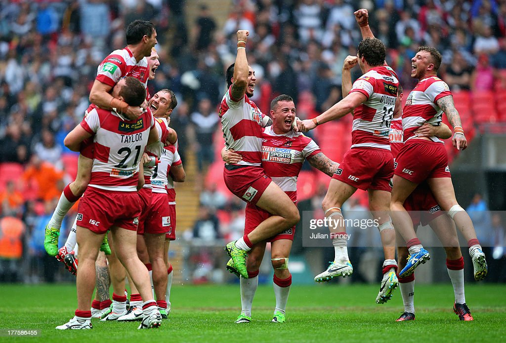 Wigan Warriors players celebrate at full time during the Tetley's Challenge Cup Final between Wigan Warriors and Hull FC at Wembley Stadium on August...