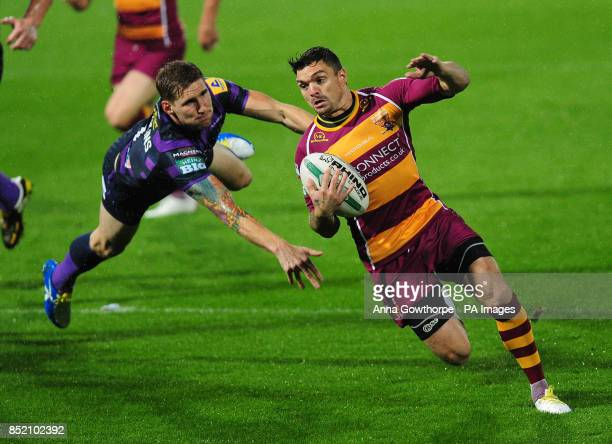 Wigan Warriors' Sam Tomkins fails to stop Huddersfield Giants' Danny Brough from scoring a try during the Super League Elimination Play Off at the...