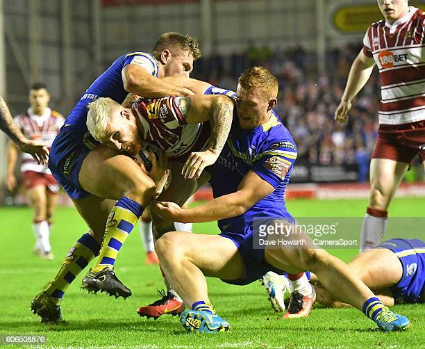 Wigan Warriors' Sam Tomkins goes over for his sides 2nd try during the First Utility Super League Super 8s Round 6 match between Warrington Wolves...