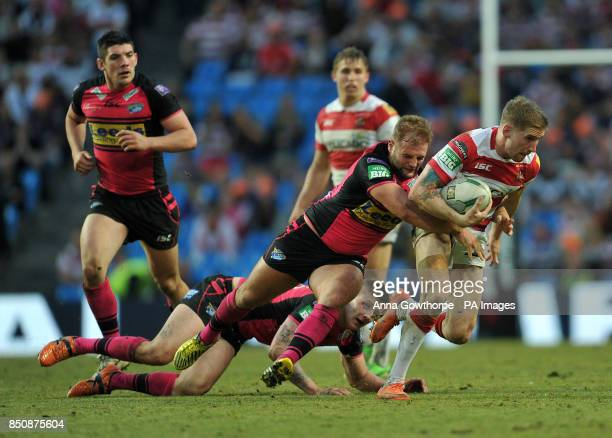 Wigan Warriors' Sam Tomkins is tackled by Leeds Rhinos' Paul McShane during the Super League Magic Weekend at the Etihad Stadium Manchester