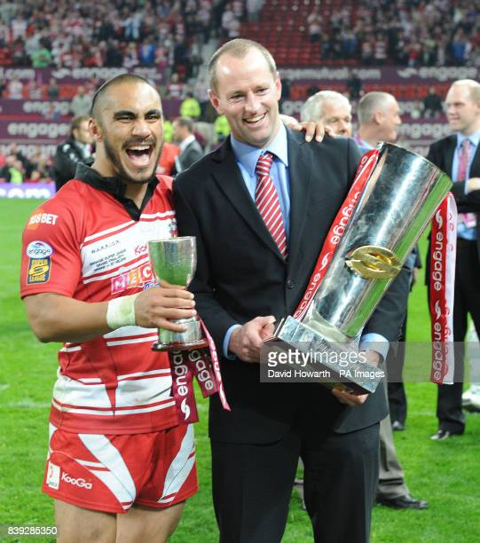 Wigan Warriors' Thomas Leuluai and Wigan Warriors' Head Coach Michael Maguire with the trophy during the engage Super League Grand Final at Old...