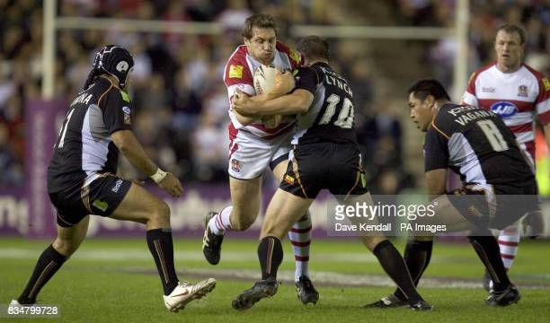 Wigan's Andy Coley is tackled by Bradford's Andy Lynch during the Engage Super League Elimination Playoff at Stobart Stadium Widnes