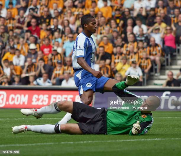 Wigan's Antonio Valencia beats Hull goal keeper Bo Myhill during the Barclays Premier League match at the Kingston Communications Stadium Hull