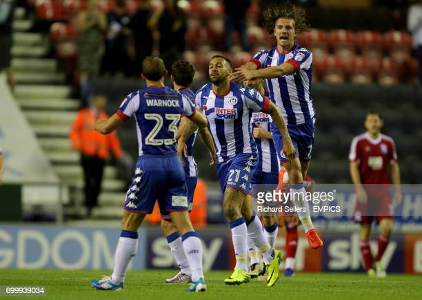 Wigan's Craig Davies celebrates his equaliser with Wigan's Alex Gilbey and Wigan's Stephen Warnock