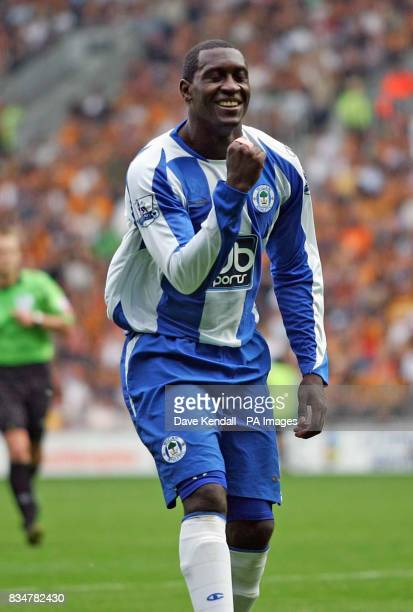 Wigan's Emile Heskey celebrates his 2nd half goal during the Barclays Premier League match at the Kingston Communications Stadium Hull