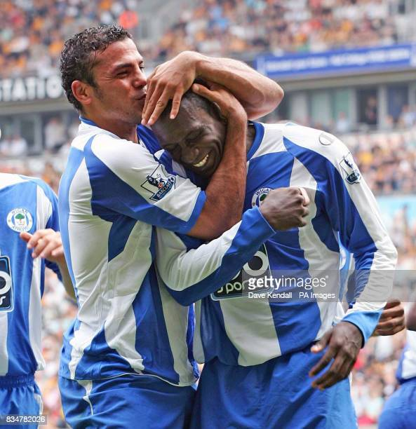 Wigan's Emile Heskey celebrates his goal with Amr Zaki during the Barclays Premier League match at the Kingston Communications Stadium Hull