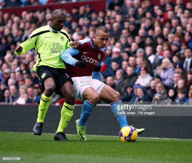 Wigan's Emmerson Boyce and Aston Villa's Gabriel Agbonlahor in action during the Barclays Premier League match at Villa Park Birmingham