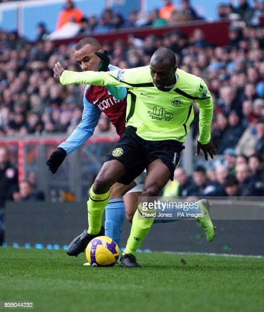Wigan's Emmerson Boyce shields the ball from Aston Villa's Gabriel Agbonlahor during the Barclays Premier League match at Villa Park Birmingham