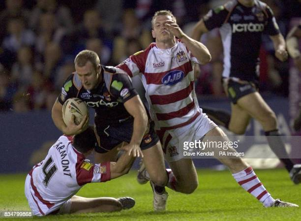 Wigan's George Carmont brings down Bradford's Michael Platt during the Engage Super League Elimination Playoff at Stobart Stadium Widnes