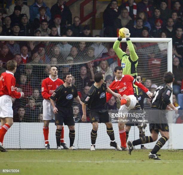 Wigan's goalkeeper John Filan catches the ball after a Rotherham cross