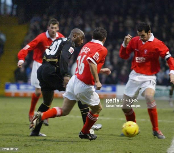 Wigan's Jason Roberts runs past Rotherham's Paul Hurst
