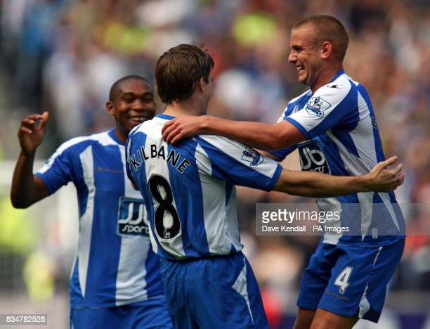 Wigan's Kevin Kilbane celebrates his goal with Lee Cattermole during the Barclays Premier League match at the Kingston Communications Stadium Hull