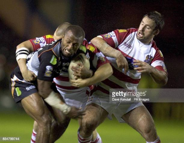 Wigan's Phil Bailey moves in to tackle Bradford's Semi Tadulala during the Engage Super League Elimination Playoff at Stobart Stadium Widnes