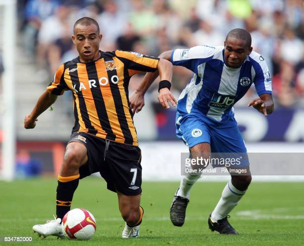 Wigan's Wilson Paacios is beaten to the ball by Hull's Craig Fagan during the Barclays Premier League match at the Kingston Communications Stadium...