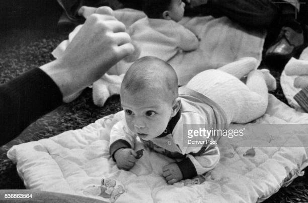 Wiggling A Toy In Front Up and To The Sides Helps The Baby Learn To Turn Lift Head Anne Toomey a mother and farmer nanny who has studied books on...