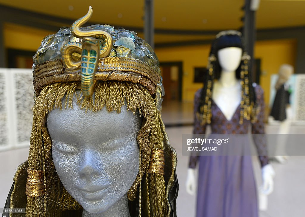Wigs and dresses worn by actress Elizabeth Taylor in 1963 film Cleopatra are displayed during an exhibition at the Italian embassy in Washington, DC, on May 1, 2013. The exhibition, titled 'Star Wigs La Mano Italian Crea' is organized to give tribute to Italian cultural and historical heritage of creating a character in the film industry, showcased wigs and costumes used in historical films and actors such as Sofia Coppola's Marie Antoniette, Fellini's Casanova, Visconti's Angelica, Jane Fonda's Barbarella, Nicole Kidman's Moulin Rouge and Elizabeth Taylor's Cleopatra. AFP PHOTO/Jewel Samad