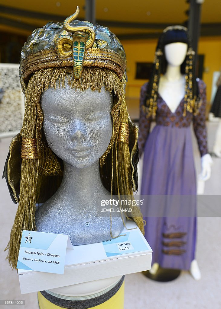 Wigs and dresses worn by actress Elizabeth Taylor in the 1963 film Cleopatra are displayed during an exhibition at the Italian embassy in Washington, DC, on May 1, 2013. The exhibition, titled 'Star Wigs La Mano Italian Crea' is organized to give tribute to Italian cultural and historical heritage of creating a character in the film industry, showcased wigs and costumes used in historical films and actors such as Sofia Coppola's Marie Antoniette, Fellini's Casanova, Visconti's Angelica, Jane Fonda's Barbarella, Nicole Kidman's Moulin Rouge and Elizabeth Taylor's Cleopatra. AFP PHOTO/Jewel Samad