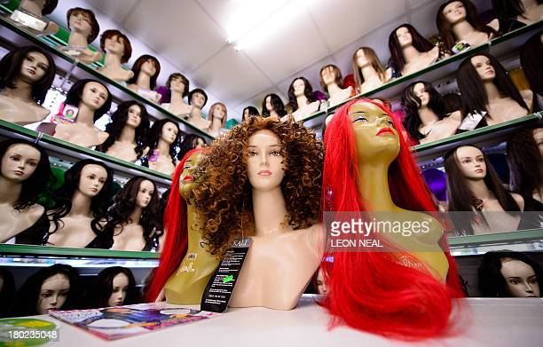 Wigs are displayed in a large wig salesroom in Finsbury Park north London on September 10 2013 AFP PHOTO / LEON NEAL