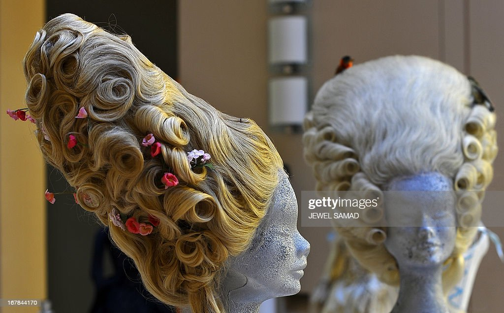 Wigs worn in the 2006 film Marie Antoniette directed by Sofia Coppola are displayed during an exhibition at the Italian embassy in Washington, DC, on May 1, 2013. The exhibition, titled 'Star Wigs La Mano Italian Crea' is organized to give tribute to Italian cultural and historical heritage of creating a character in the film industry, showcased wigs and costumes used in historical films and actors such as Sofia Coppola's Marie Antoniette, Fellini's Casanova, Visconti's Angelica, Jane Fonda's Barbarella, Nicole Kidman's Moulin Rouge and Elizabeth Taylor's Cleopatra. AFP PHOTO/Jewel Samad