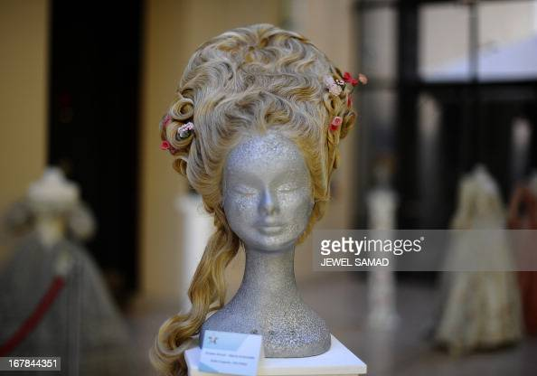 Wigs worn in the 2006 film Marie Antoniette directed by Sofia Coppola are displayed during an exhibition at the Italian embassy in Washington DC on...