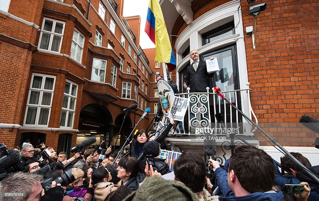 TOPSHOT WikiLeaks founder Julian Assange addresses media and supporters from the balcony of Ecuador's embassy in central London on February 5 2016...