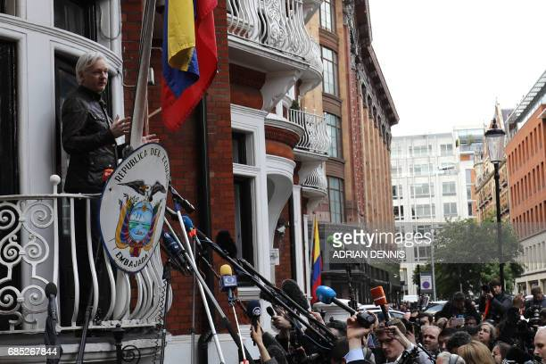Wikileaks founder Julian Assange appears on the balcony of the Embassy of Ecuador in London on May 19 2017 Ecuador urged Britain today to 'grant safe...